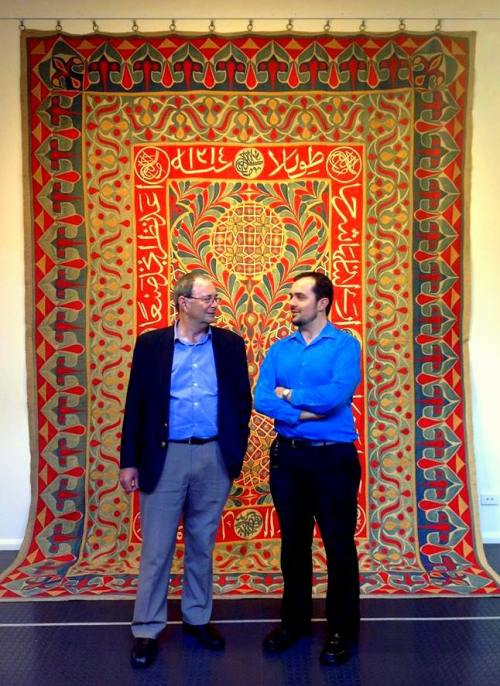 "Bob and Sam Bowker chatting in front of the ""Milan Panel"", a Khedival Khayamiya dated 1899."